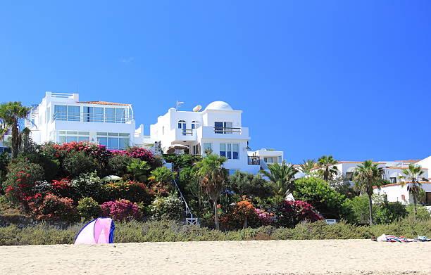 Luxury beachfront holiday villas. stock photo
