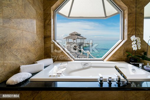 istock Luxury beautiful interior design on beach resort, window view from bathroom on clear blue sea, summer vacation in Phuket, Thailand. Summer, Travel, Vacation and holiday concept. 835931854