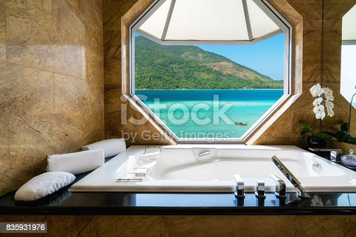 istock Luxury beautiful interior design on beach resort, window view from bathroom on clear blue sea, summer vacation in Phuket, Thailand. Summer, Travel, Vacation and holiday concept. 835931976
