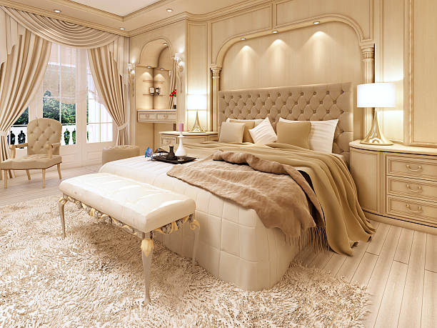 Luxury bed in a large neoclassical bedroom with decorative niche