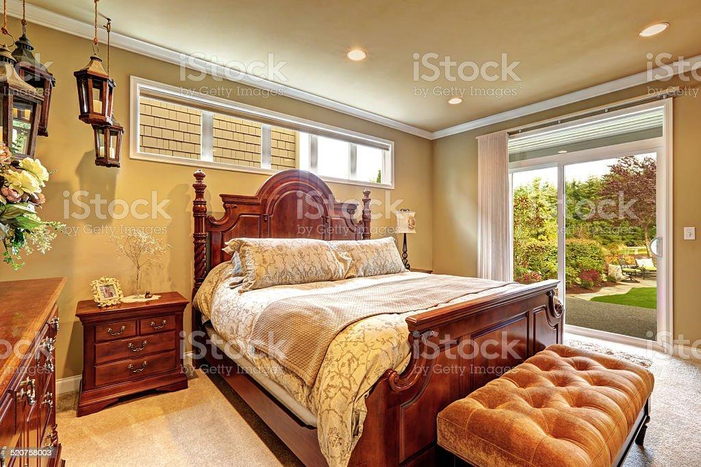 Luxury bedroom carved wood furniture set stock photo