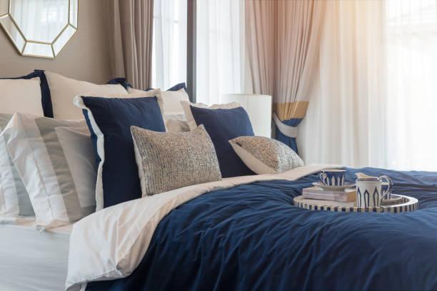 luxury bedroom in indigo blue tone stock photo