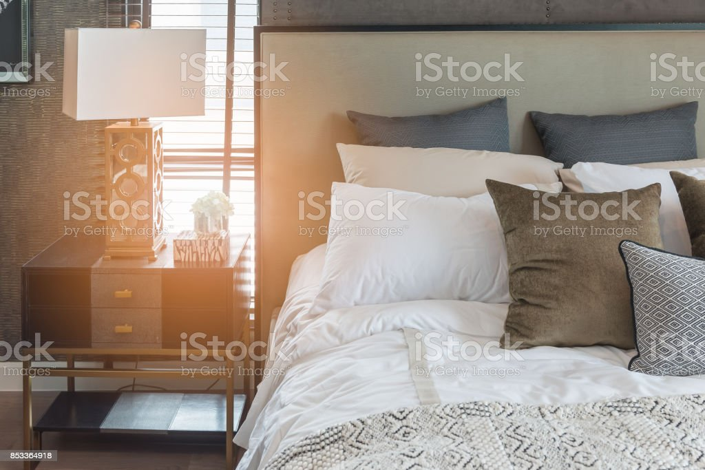 luxury bedroom style with set of pillows stock photo