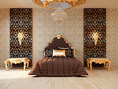 Luxury bedroom with golden furniture in royal interior