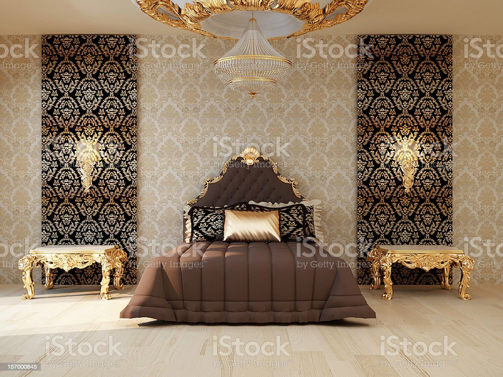 Luxury bedroom with golden furniture in royal interior stock photo