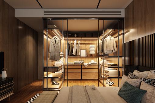 Interior of an empty luxury bedroom with walk-in closet.