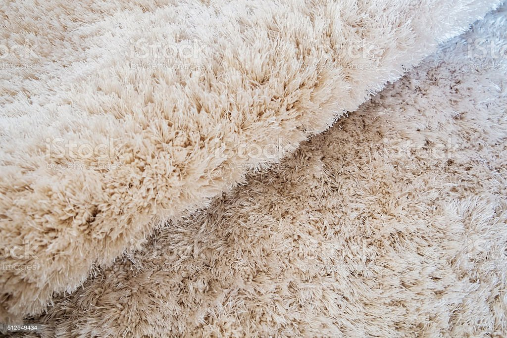luxury bend beige carpet texture background stock photo