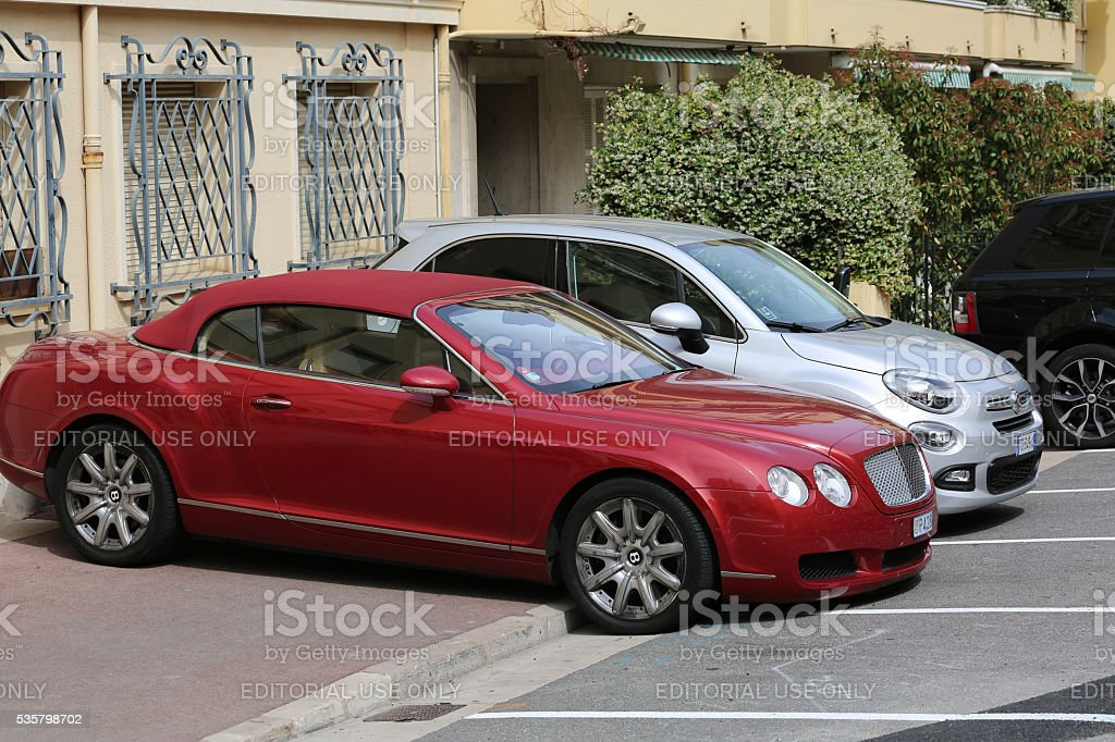 Luxury Bentley Continental GTC Badly Parked on the Sidewalk stock photo