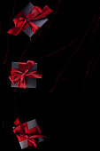 istock Luxury black gift boxes with green ribbon 1180949951