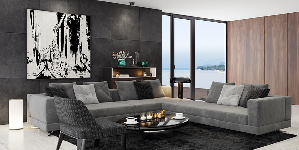 Luxury apartment with living room interior and modern minimalist Italian style furniture with big art wall image.\nMatte black cabinets. Black carpet. Grey sofa with armchair. Glossy black cafe table. \nOcean seaside background image (my photo). Floor is light matte marble tiles. Wooden panel walls.\nItalian style interior design. 3d rendering