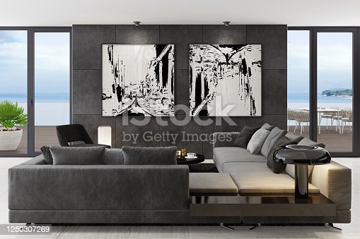 Luxury apartment with living room interior and modern minimalist furniture with big wall art. Matte black wall tiles. Black carpet. Grey sofa with armchair. Glossy black cafe table.  Ocean seaside background image (my photo). Floor is light matte marble tiles. Grey walls. Italian style interior design. 3d rendering