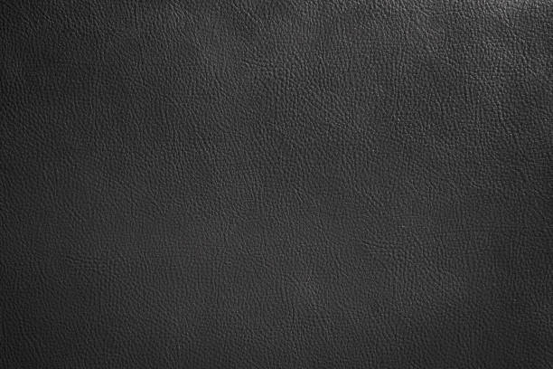 Luxury black leather texture background, Close up detail sofa leather and texture stock photo