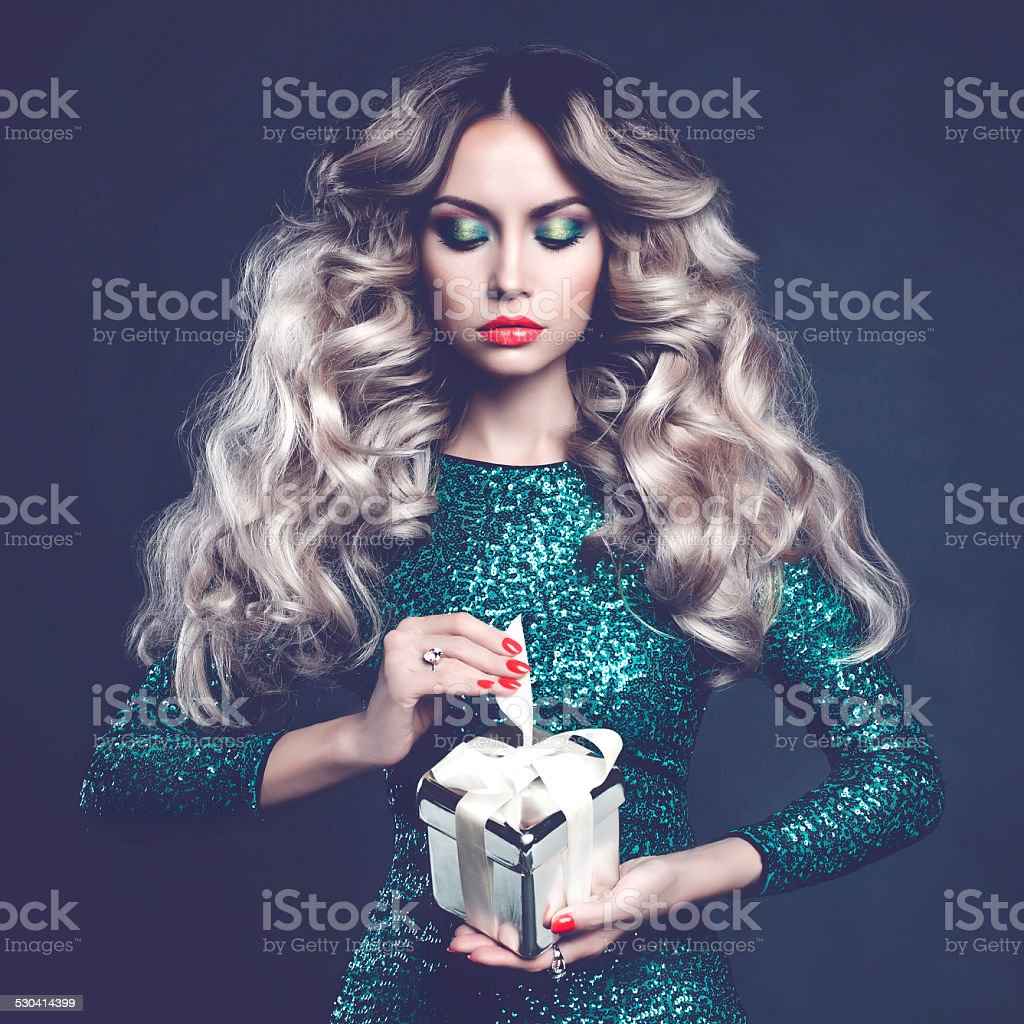 Luxury blonde with a gift stock photo