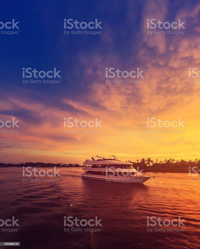 luxury boat at sunset stock photo