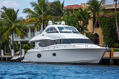 Large luxury boat  docked at the owners waterfront home.  RM