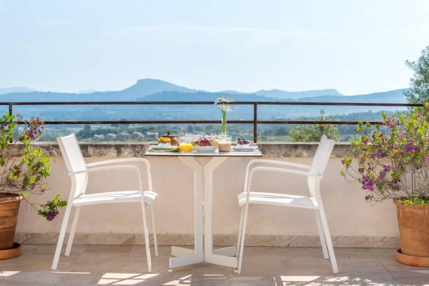 Luxury breakfast on hotel room table in terrace stock photo