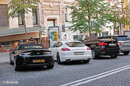 August 14, 2011, Kiev - Ukraine. Luxury british car Aston Martin Vantage. Porsche Panamera. BMW X6 M Hamann.