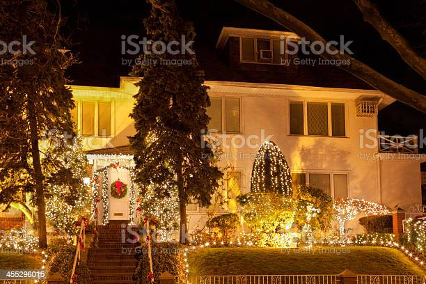 Photo of Luxury Brooklyn House with Christmas Lights at sunset, New York.