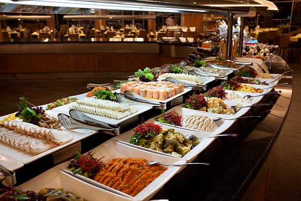 Luxury Buffet Luxury Buffet in a hotel restaurant. Focus on sushi. buffet stock pictures, royalty-free photos & images