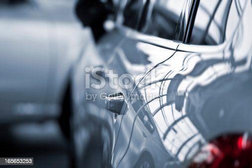 istock Luxury car at public dealership 165653253