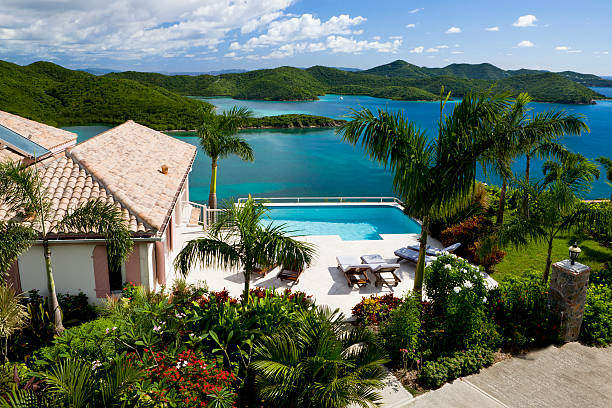 luxury Caribbean villa in the Virgin Islands - tropical vacation luxury Caribbean villa with a pool overlooking the Virgin Islands - perfect exotic vacation getaway villa stock pictures, royalty-free photos & images