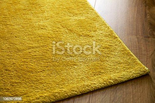 Luxury carpet on laminate wood floor