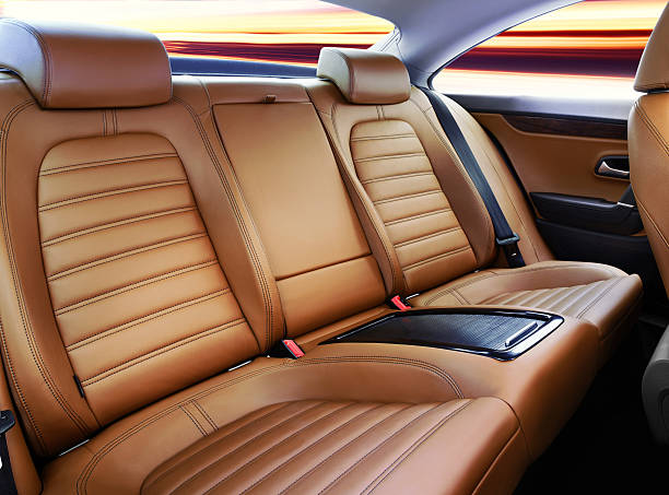 Luxury car's passenger seat interior in tan leather
