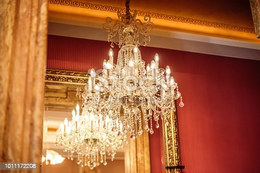 Close up view of chandelier in luxury vintage mansion.