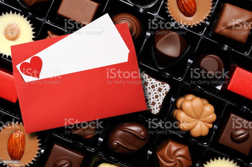 Luxury Chocolates with Valentine card stock photo