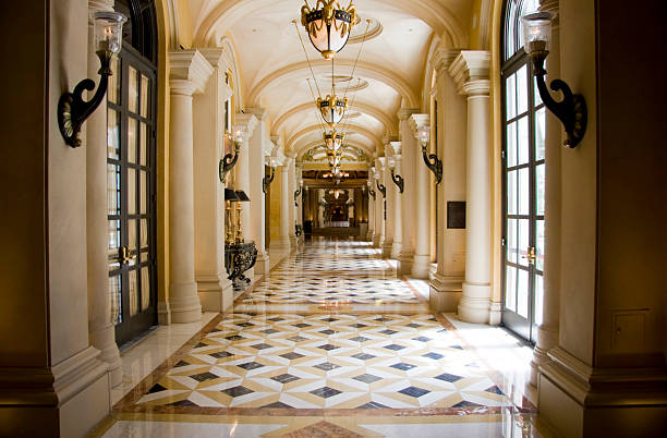 luxury classic colonnade corridor - stately home stock photos and pictures