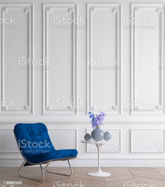 Luxury classic interior with dark blue armchair, concept classic blue color of the year 2020 in interior