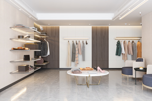 Luxury Clothing Store With Clothes, Shoes And Other Personal Accessories.