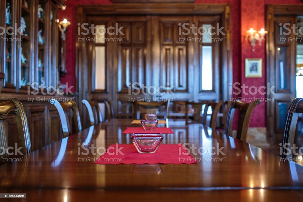 Luxury interior of empty coffee shop with wooden tables and chairs.