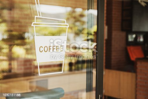 istock Luxury coffee shop sign on the glass door. For art texture or web design backgrund. 1030151188