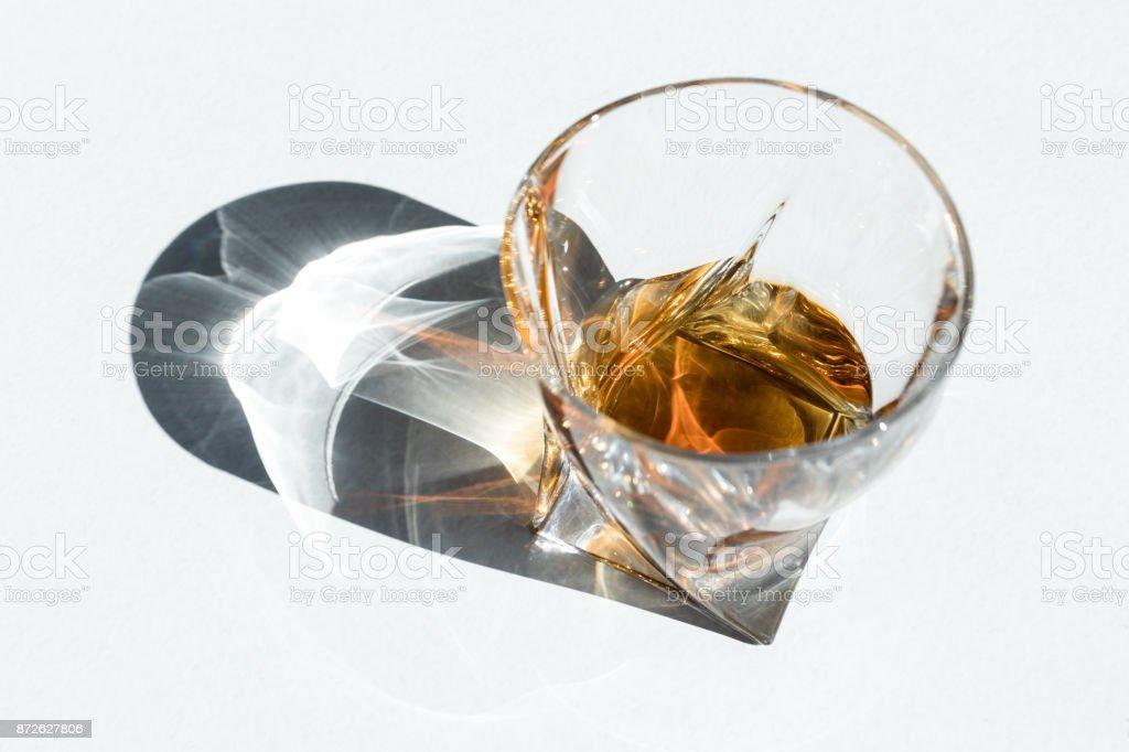 luxury cognac in glass on white stock photo