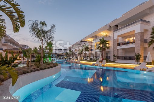 istock Luxury Construction hotel with Swimming Pool at sunset 903417402