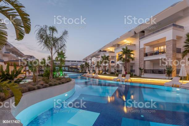 Luxury construction hotel with swimming pool at sunset picture id903417402?b=1&k=6&m=903417402&s=612x612&h=pqwry91ycy0yxqwgbustxaa9 npdpnbhqo3mztyvxny=