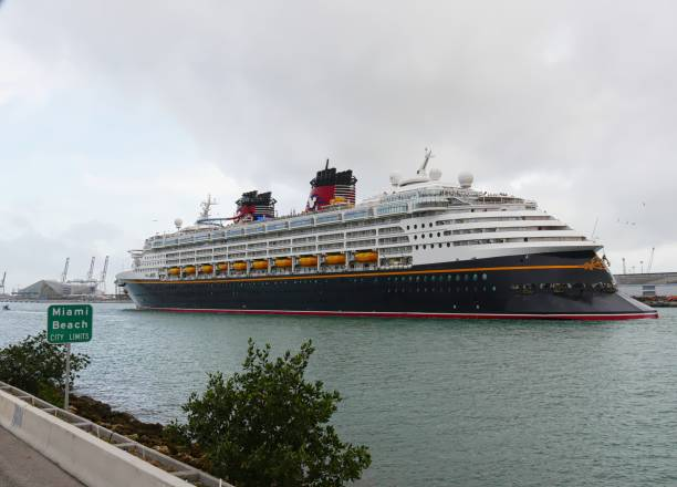 Luxury cruise liner for disney cruises glides along the channel for picture id1221412659?b=1&k=6&m=1221412659&s=612x612&w=0&h=pvuepnhcmwqsk8usng1sih0cgkziql1thzoec4dslw0=