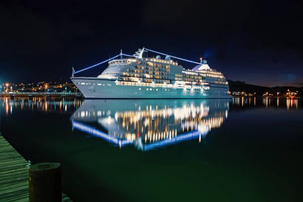 luxury cruise ship at sunset stock photo