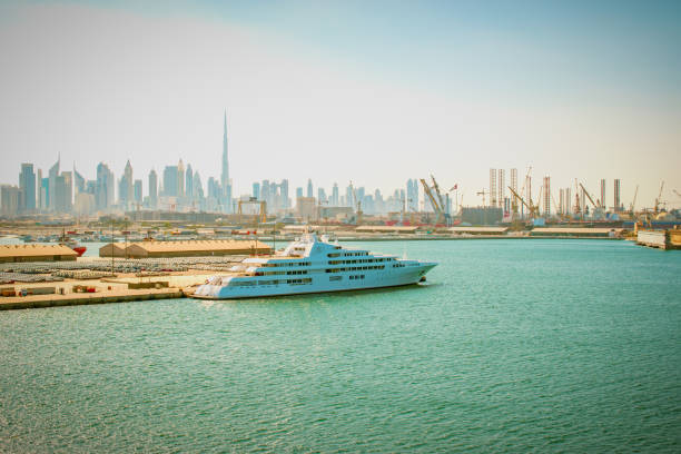 Luxury cruise travel in Dubai. Cruise ship or yacht in port of Dubai, United Arab Emirates, Middle East. mooring stock pictures, royalty-free photos & images