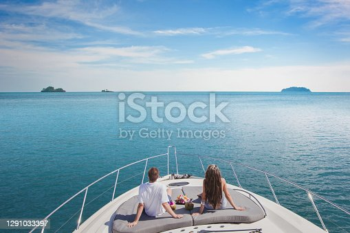 istock luxury cruise travel on the yacht, romantic honeymoon vacation for couple 1291033397