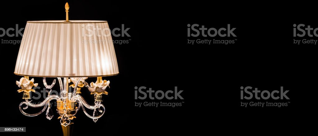 Luxury crystal glass lamp isolated on a black background.  Modern expensive table lamp stock photo