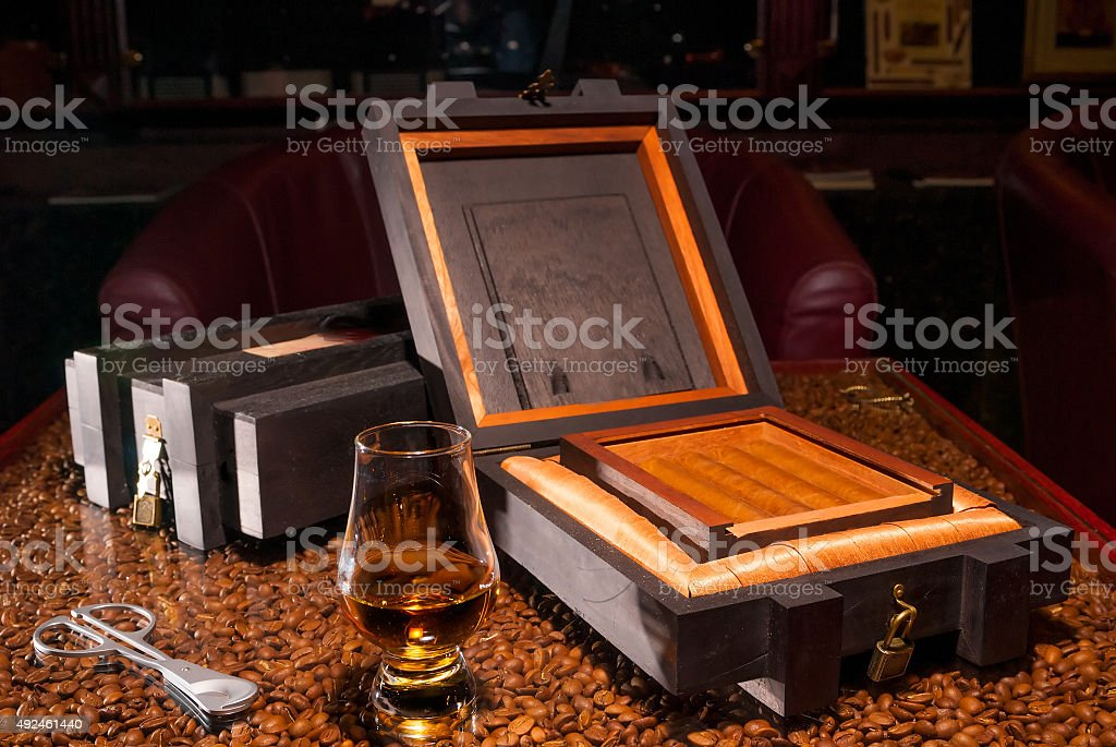 luxury Cuban cigars in a box and  glass of alcohol stock photo