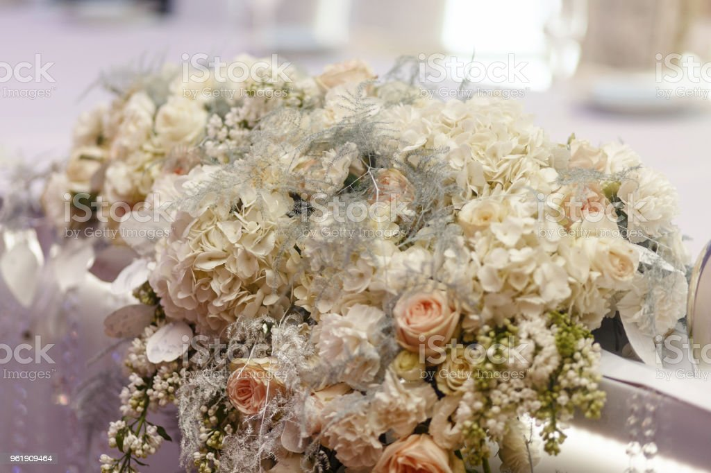 luxury decorated tables with hydrangea and roses at rich wedding reception. stylish arrangements of flowers and jewels on table, expensive catering. space for text stock photo