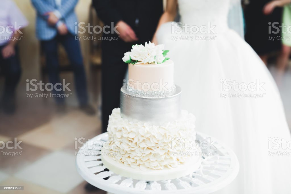 Luxury decorated wedding cake on the table stock photo