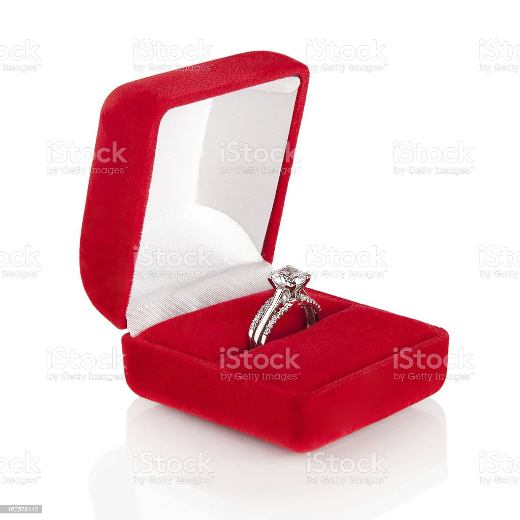Luxury Diamond Wedding Ring In Red Velvet Silk Box stock photo | iStock
