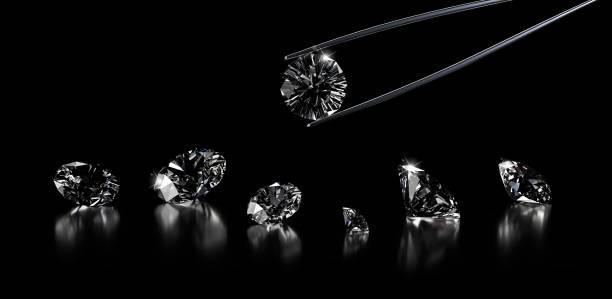 luxe diamanten op een zwarte achtergrond - diamant stockfoto's en -beelden
