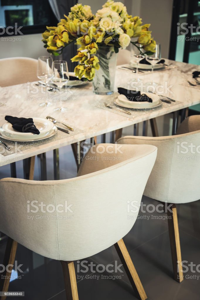 luxury dinning room with wooden table and classic style chair stock photo