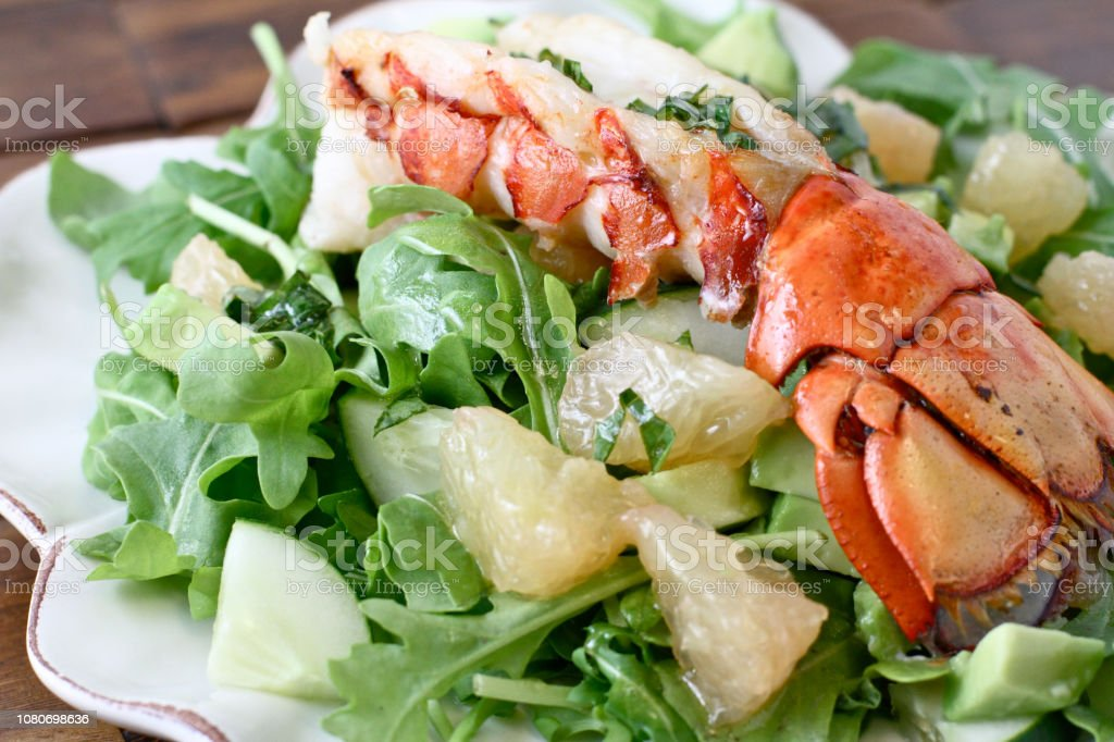 A luxury dish of lobster salad with herbs and vegetables close up
