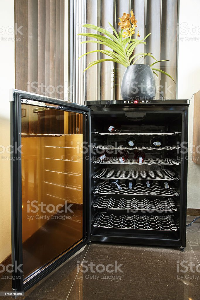 Luxury electronic wine cooler with door open stock photo